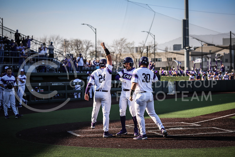 Senior Cameron Thompson being congratulated by Sophomore Dylan Phillips and Senior Chris Ceballos after bringing in a run on Friday's game (April 3, 2021) against Texas Tech at Tointon Stadium. <br /> Elizabeth Proctor Collegian Media Group