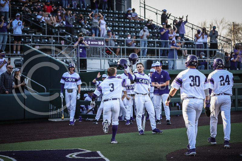 Senior Cameron Thompson being congratulated by his teammates after bringing in a run on Friday's game (April 3, 2021) against Texas Tech at Tointon Stadium. <br /> Elizabeth Proctor Collegian Media Group