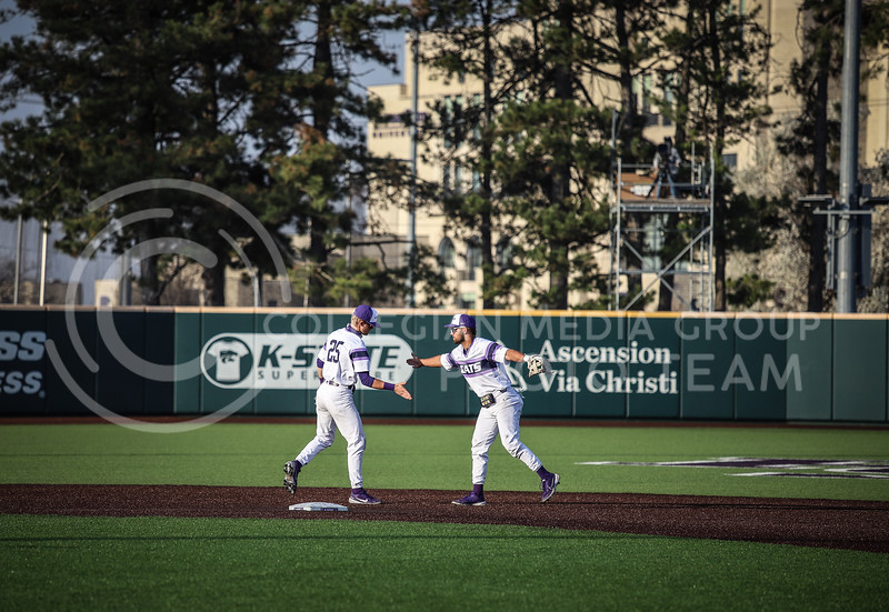 Sophomore Daniel Carincl and Freshman Nick Goodwin congratulating each other after a play on Friday's game (April 3, 2021) against Texas Tech at Tointon Stadium. <br /> Elizabeth Proctor Collegian Media Group
