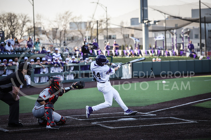 Junior Dylan Caplinger up to bat and swinging on Friday's game (April 3, 2021) against Texas Tech at Tointon Stadium. <br /> Elizabeth Proctor Collegian Media Group