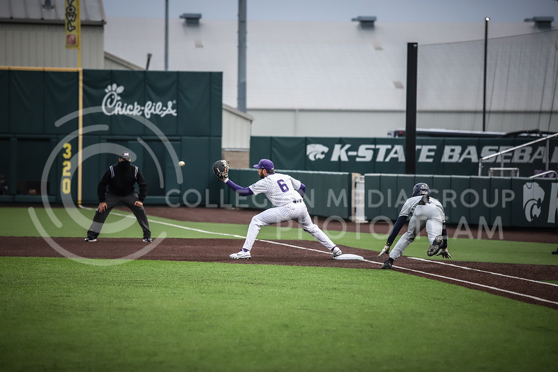 Junior Terrence Spurin catching the ball at first base on Friday's game ( April 23, 2021) against Western Virginia at Tointon Stadium. <br /> Elizabeth Proctor  Collegian Median Group