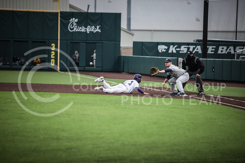 Senior Cameron Thompson diving back to first base on Friday's game ( April 23, 2021) against Western Virginia at Tointon Stadium. <br /> Elizabeth Proctor  Collegian Median Group