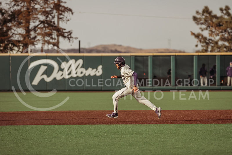 Junior Terrence Spurlin hustles to third base during the teams season opener against Western Michigan on February 26th at Tointon Family Stadium. (Sophie Osborn | Collegian Media Group)