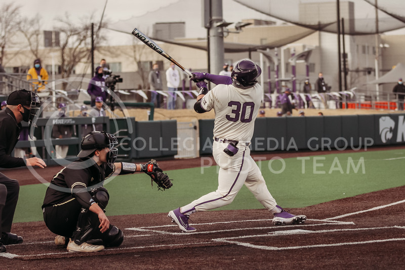 Senior catcher Chris Ceballos hits the ball into the outfield during the teams season opener against Western Michigan on February 26th at Tointon Family Stadium. (Sophie Osborn | Collegian Media Group)