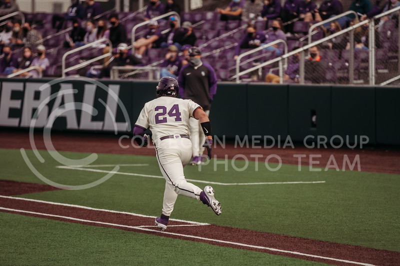 Sophomore Dylan Phillips runs to first base after hitting during the teams season opener against Western Michigan on February 26th at Tointon Family Stadium. (Sophie Osborn | Collegian Media Group)