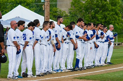 Members of the 2018 North Adams Steeplecats baseball team spend a moment of silence before the start of their home opener Thursday.