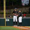 Georgia outfielder Stephen Wrenn (11) talks with volunteer coach Jimmy Rider during the NCAA baseball game between Georgia and Georgia Tech at Foley Field on Tuesday, April 26, 2016 in Athens, Ga. (Photo by Emily Selby)