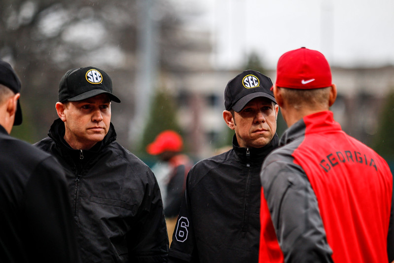 Umpires speak to Georgia head coach Scott Stricklin during the Bulldogs' game against College of Charleston at Foley Field in Athens, GA (Photo by John Paul Van Wert / Georgia Sports Communications)