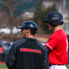 Georgia catcher Austin Biggar (8) and volunteer Coach Jimmy Rider during the Bulldogs' game against Charleston at Foley Field in Athens, Ga., on Sunday, February 19, 2017. (Photo by Cory A. Cole)