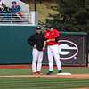 Georgia outfielder Keegan McGovern (32) and Coach Scott Daeley (9) during the Bulldogs' game against Charleston at Foley Field in Athens, Ga., on Sunday, February 19, 2017. (Photo by Cory A. Cole)