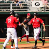 Georgia outfielder Keegan McGovern (32) and catcher Austin Biggar (8) during the Bulldogs' game against Charleston at Foley Field in Athens, Ga., on Sunday, February 19, 2017. (Photo by Cory A. Cole)