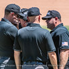 The umps discuss an interference call