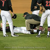 Emerson Hancock is examined by Sean Boland after an injury  – Georgia vs. Texas A&M – March 30, 2018