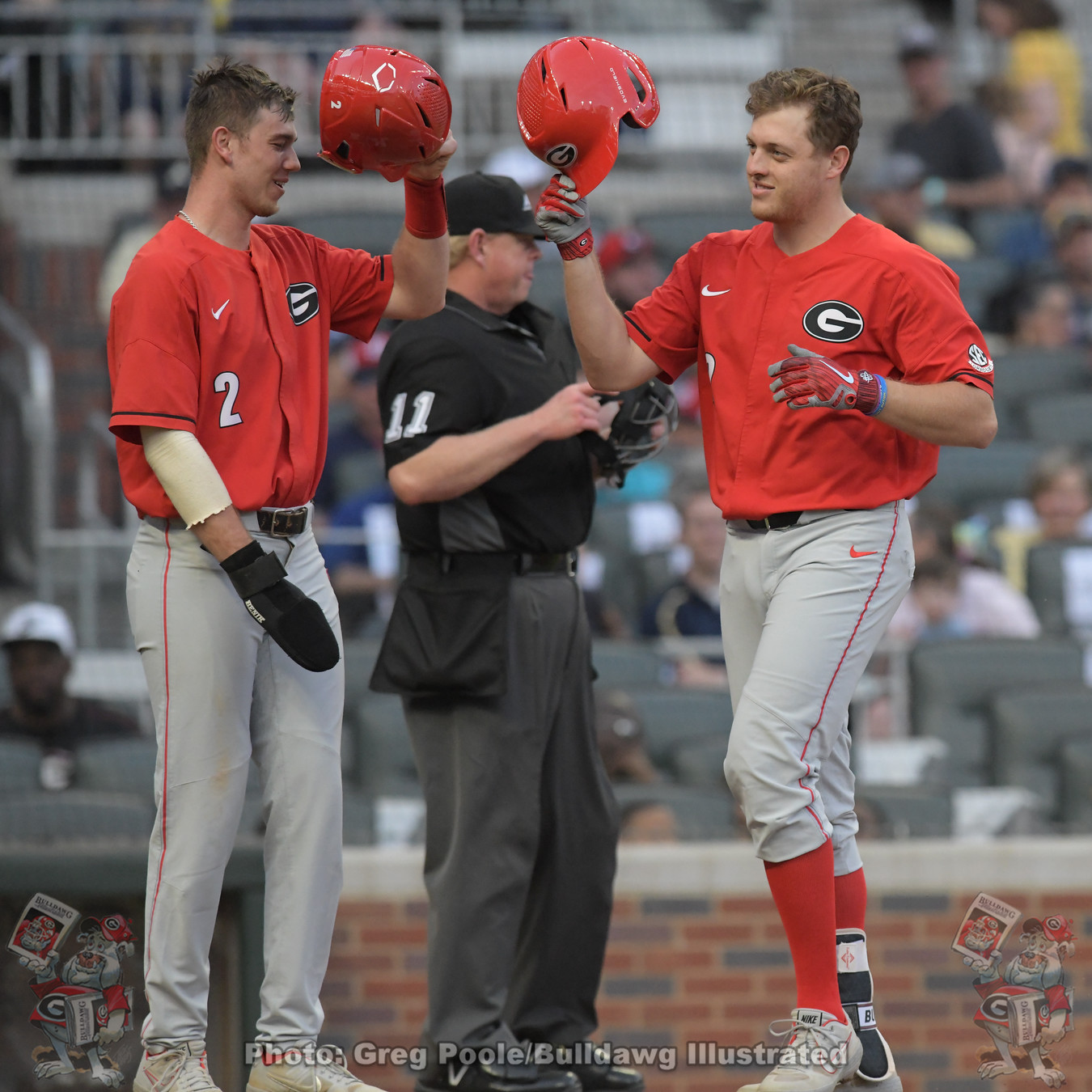 LJ Talley and John Cable celebrate Cable's homer run