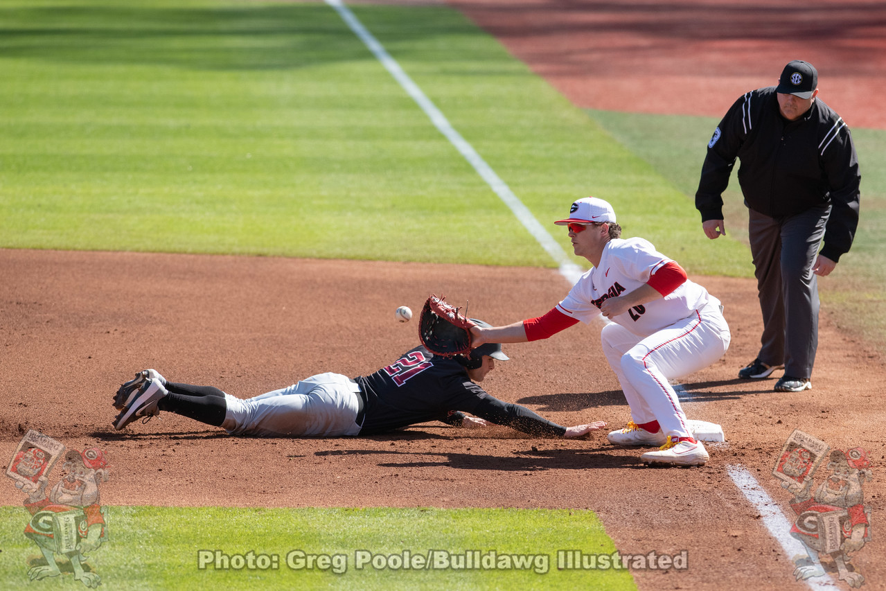 Georgia's Cole Wilcox checks Santa Clara's Mike Bowes sending him scrambling and sliding back to first with the throw to first basemen Chaney Rogers (20) in the top of the 4th in the first game of Saturday's doubleheader | February 22, 2020