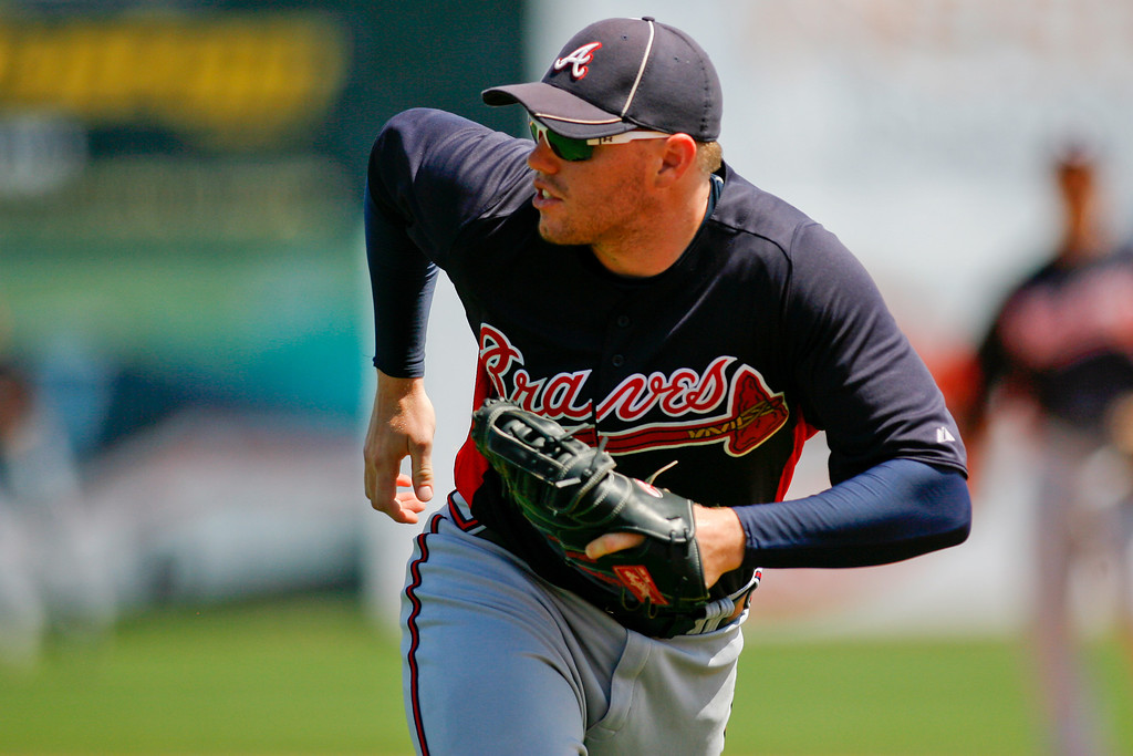 Atlanta Braves first baseman Freddie Freeman (5) runs to first to make the out during a Grapefruit League Spring Training Game at the Florida Auto Exchange Stadium.