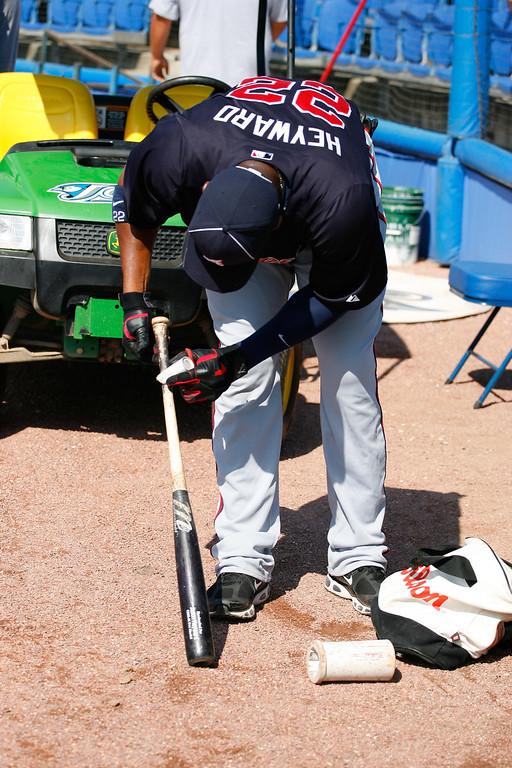Atlanta Braves right fielder Jason Heyward (22) tars his bat before beginning batting practice prior to a Grapefruit League Spring Training Game at the Florida Auto Exchange Stadium.