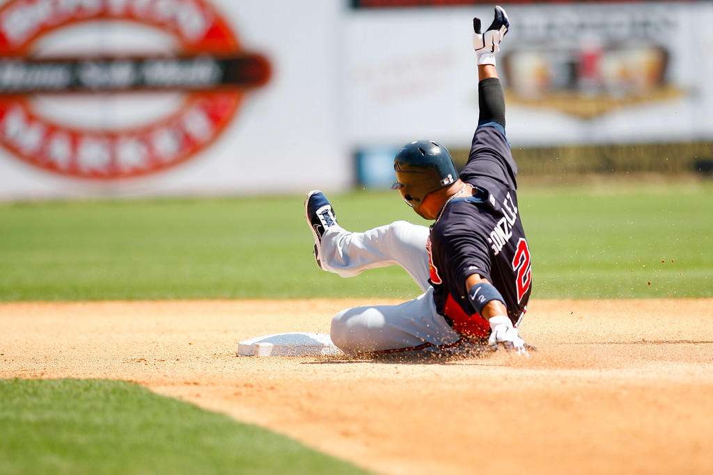 Atlanta Braves shortstop Alex Gonzalez (2) arrives safely at during a Grapefruit League Spring Training Game at the Florida Auto Exchange Stadium.