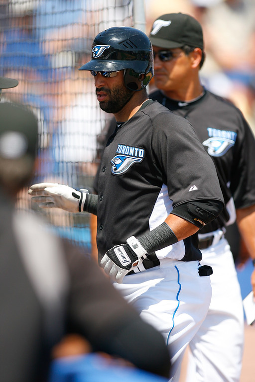Toronto Blue Jays right fielder Jose Bautista (19) returns to the dugout after hitting a home run in the bottom of the fourth inning of a Grapefruit League Spring Training Game at the Florida Auto Exchange Stadium.