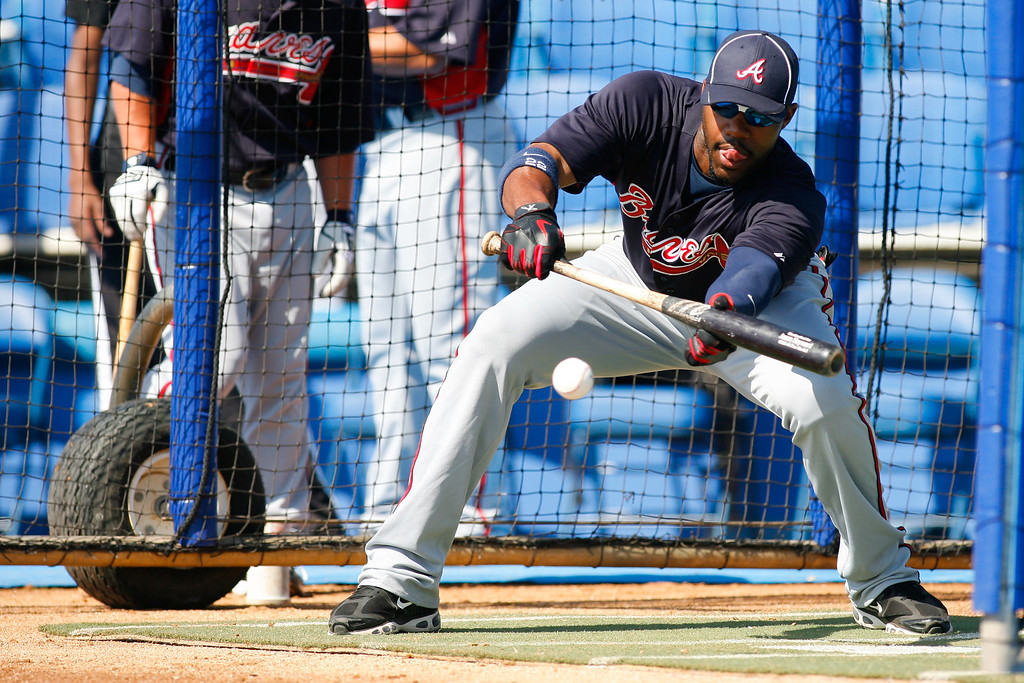 Atlanta Braves right fielder Jason Heyward (22) bunts a ball during batting practice prior a Grapefruit League Spring Training Game at the Florida Auto Exchange Stadium.