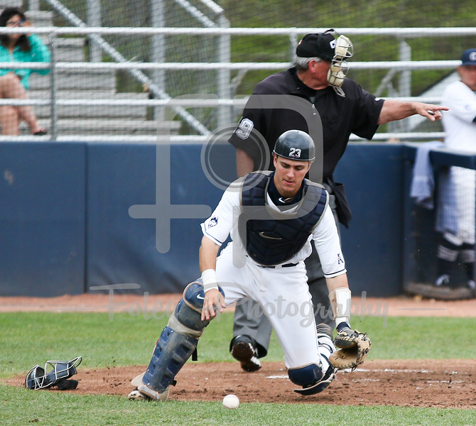 5/13/16 Storrs Connecticut: UConn catcher Zac Susi (23) chases down a ball in the dirt during an American Athletic Conference matchup. The Huskies defeated the Knights 5-4 at J.O. Christian Field in Storrs, Connecticut.