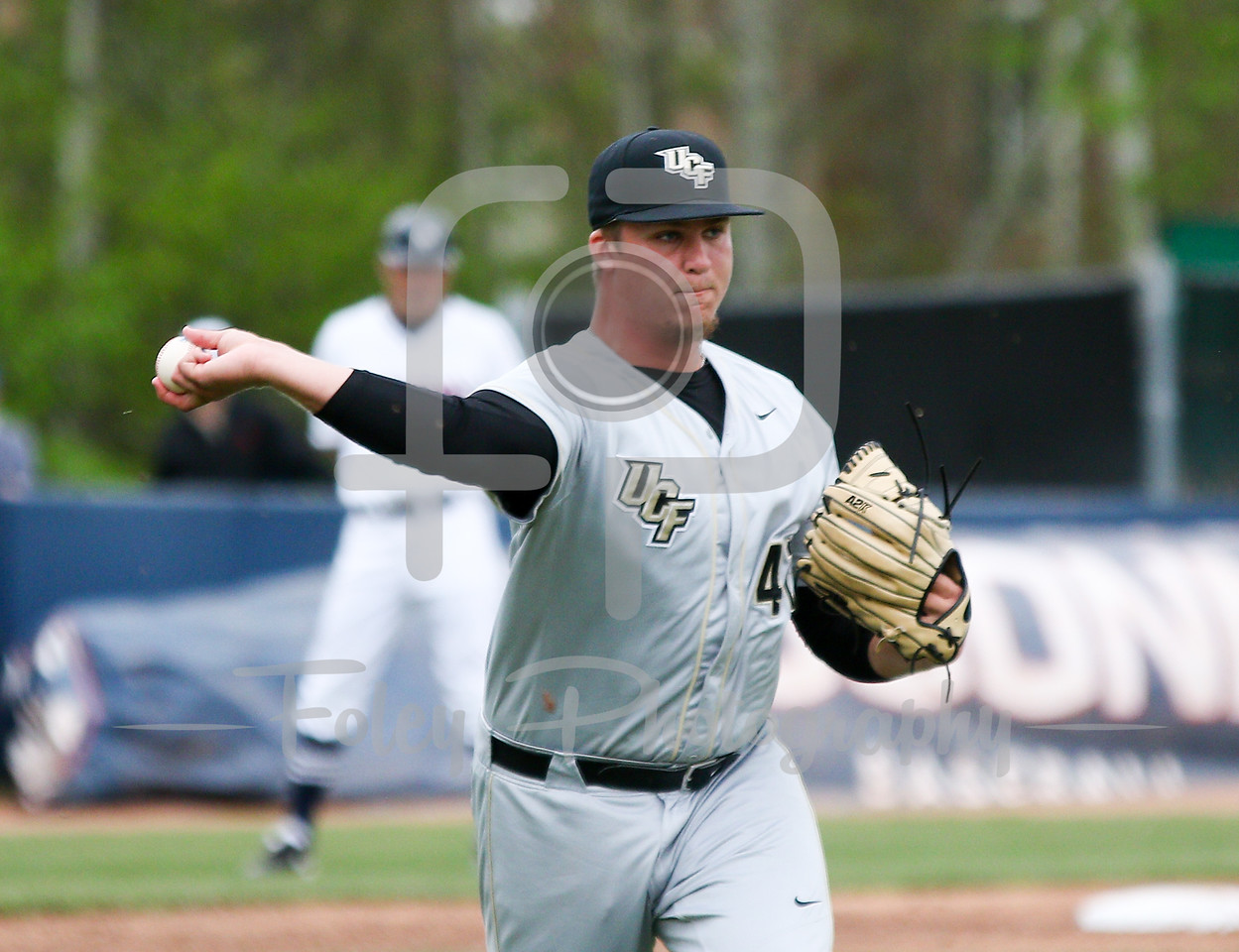 5/13/16 Storrs Connecticut: Central Florida pitcher Robby Howell throws to first base during an American Athletic Conference matchup. The Huskies defeated the Knights 5-4 at J.O. Christian Field in Storrs, Connecticut.