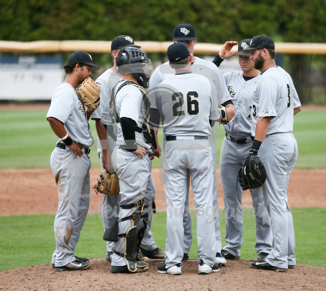 5/13/16 Storrs Connecticut: The UCF infield meets with head coach Terry Rooney during an American Athletic Conference matchup. The Huskies defeated the Knights 5-4 at J.O. Christian Field in Storrs, Connecticut.