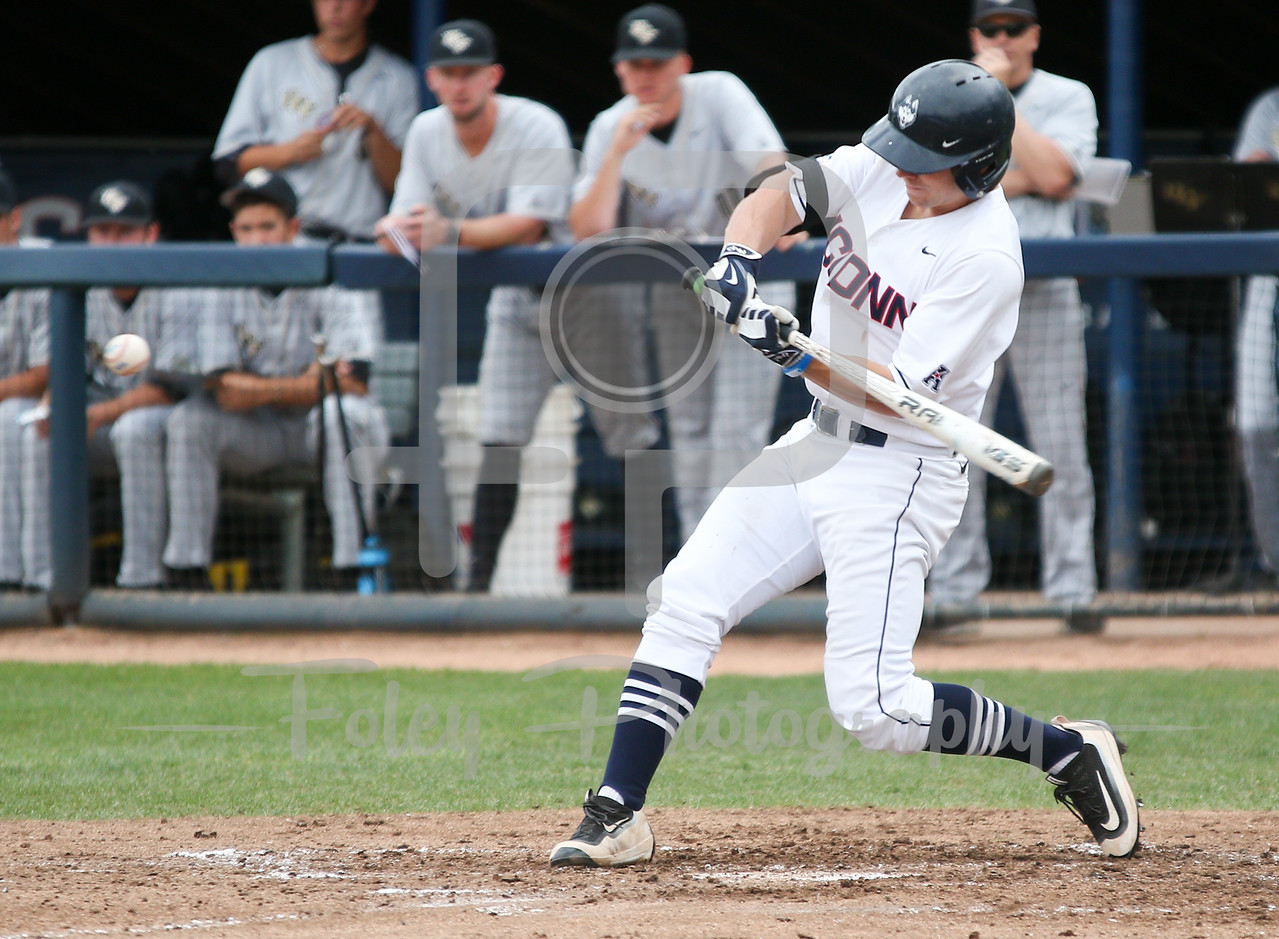 5/13/16 Storrs Connecticut: UConn's Jack Sundberg (4) swings during an American Athletic Conference matchup. The Huskies defeated the Knights 5-4 at J.O. Christian Field in Storrs, Connecticut.