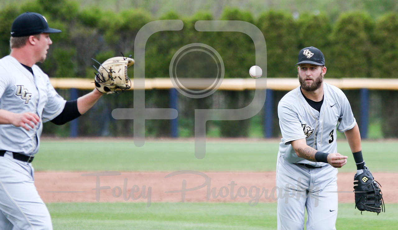 5/13/16 Storrs Connecticut: Central Florida's Kam Gelinger (3) flips to pitcher Robby Howell (41) during an American Athletic Conference matchup. The Huskies defeated the Knights 5-4 at J.O. Christian Field in Storrs, Connecticut.