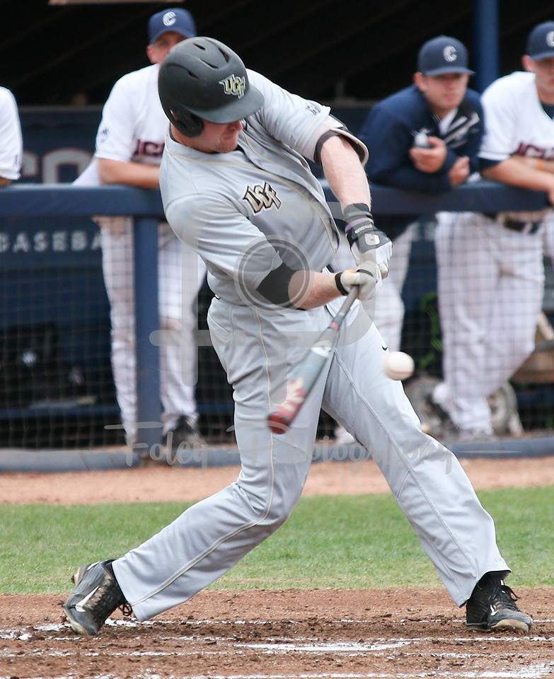 5/13/16 Storrs Connecticut: Central Florida's Eli Putnam swings during an American Athletic Conference matchup. The Huskies defeated the Knights 5-4 at J.O. Christian Field in Storrs Connecticut.