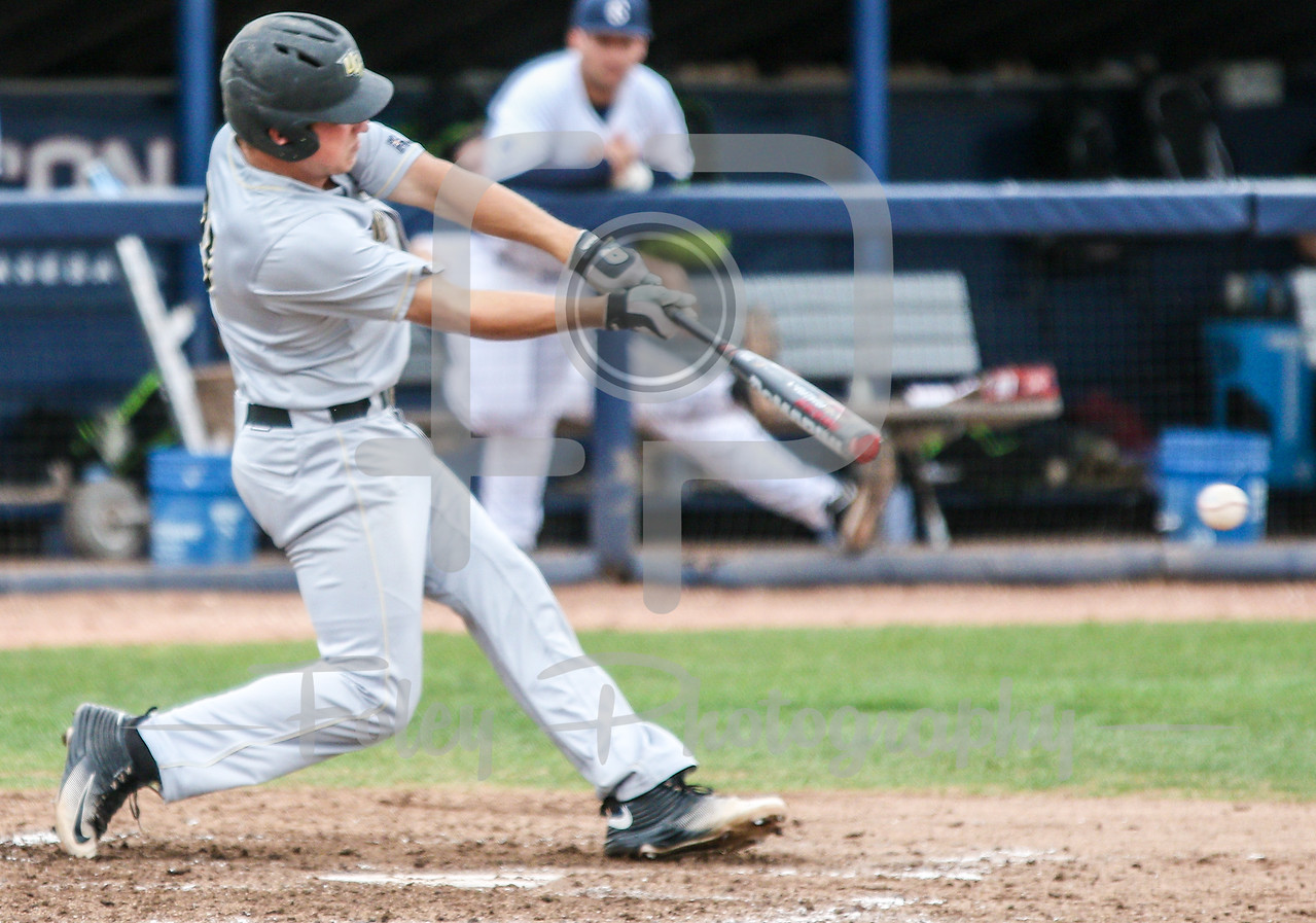 5/13/16 Storrs Connecticut: Central Florida's Brennan Bozeman (21) swings for a pitch during an American Athletic Conference matchup. The Huskies defeated the Knights 5-4 at J.O. Christian Field in Storrs, Connecticut.