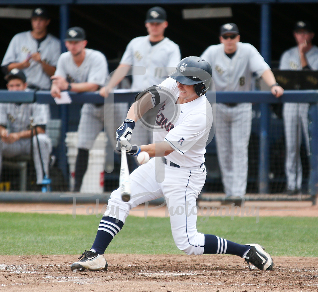5/13/16 Storrs Connecticut: UConn's Jack Sundberg (4) misses a pitch during an American Athletic Conference matchup. The Huskies defeated the Knights 5-4 at J.O. Christian Field in Storrs, Connecticut.