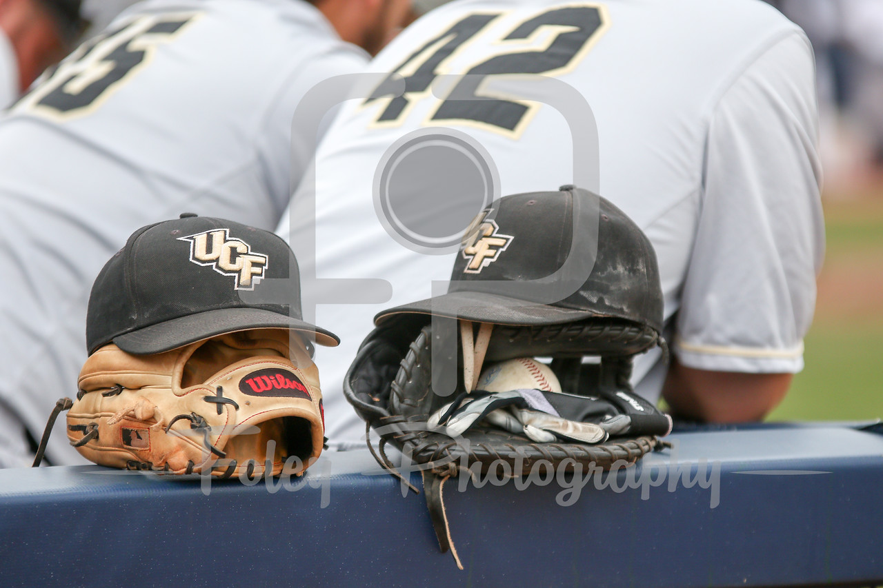 5/13/16 Storrs Connecticut: A couple of Central Florida hang on the edge during an American Athletic Conference matchup. The Huskies defeated the Knights 5-4 at J.O. Christian Field in Storrs, Connecticut.