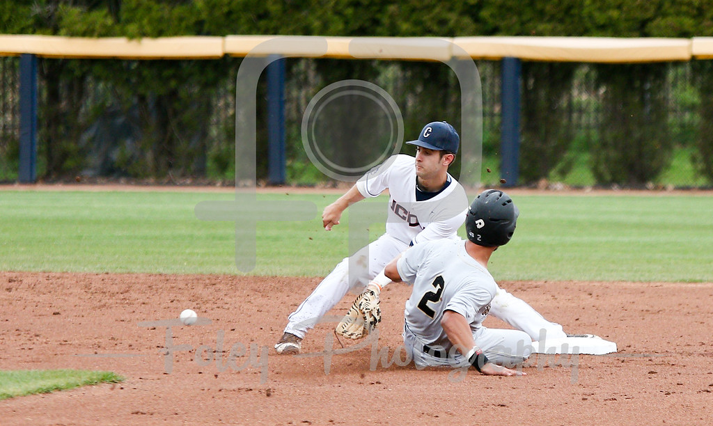 5/13/16 Storrs Connecticut: Central Florida's Matthew Mika slides into second base while UConn shortstop Bryan Daniello waits on a throw during an American Athletic Conference matchup. The Huskies defeated the Knights 5-4 at J.O. Christian Field in Storrs, Connecticut.