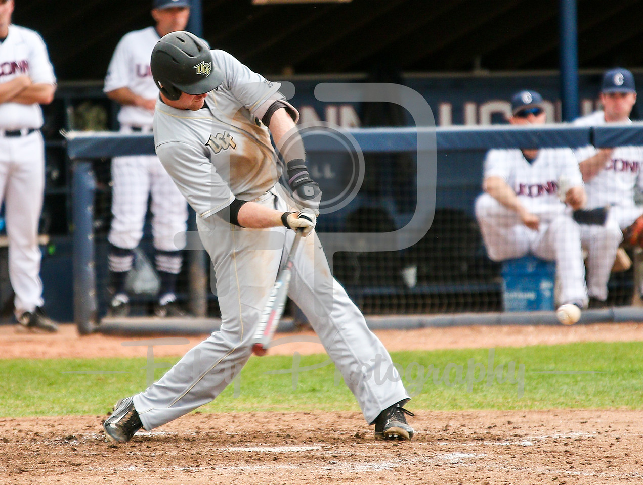 5/13/16 Storrs Connecticut: Central Florida's Eli Putnam swings during an American Athletic Conference matchup. The Huskies defeated the Knights 5-4 at J.O. Christian Field in Storrs, Connecticut.