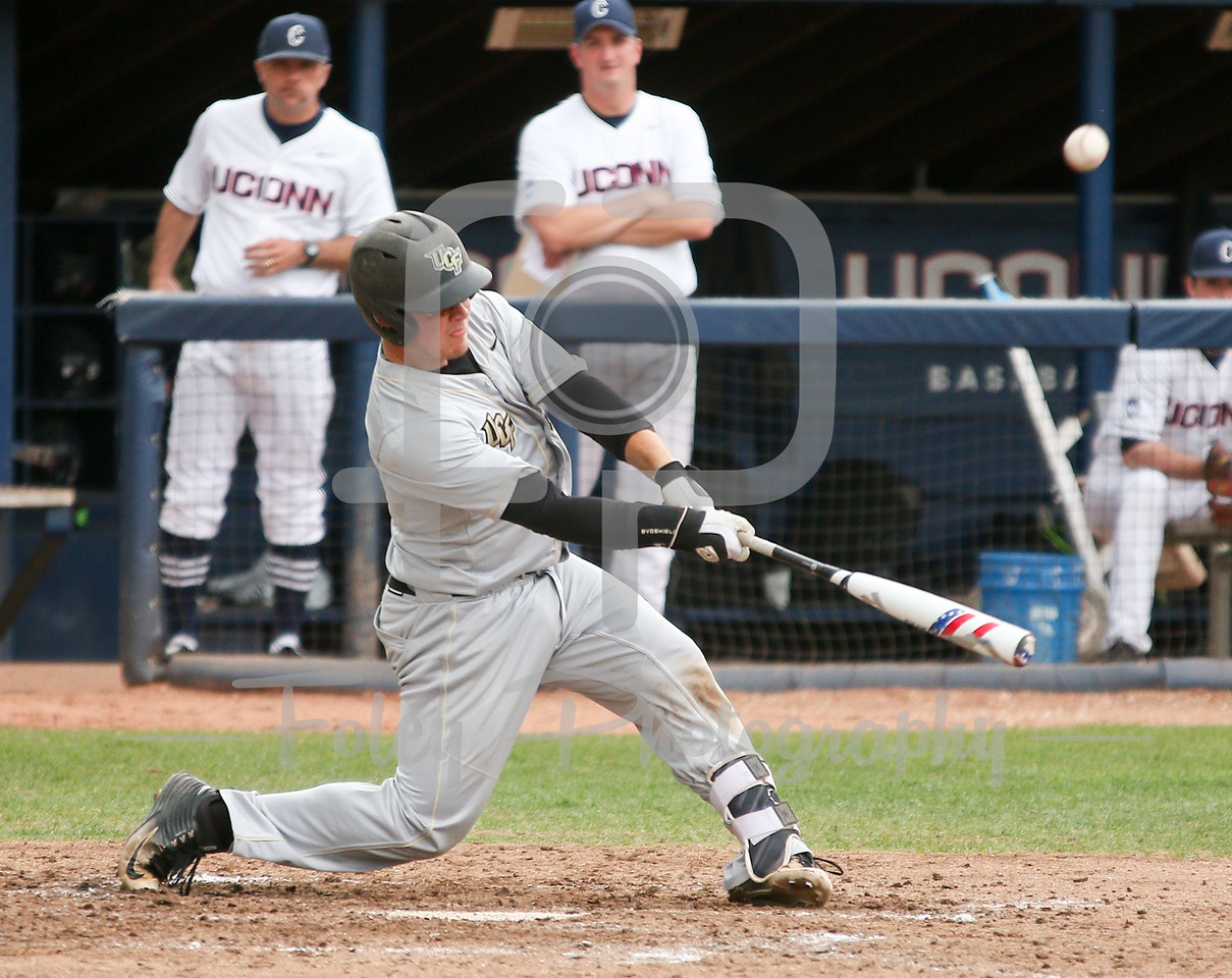 5/13/16 Storrs Connecticut: Central Florida's Logan Heiser swings for a pitch during an American Athletic Conference matchup. The Huskies defeated the Knights 5-4 at J.O. Christian Field in Storrs Connecticut.