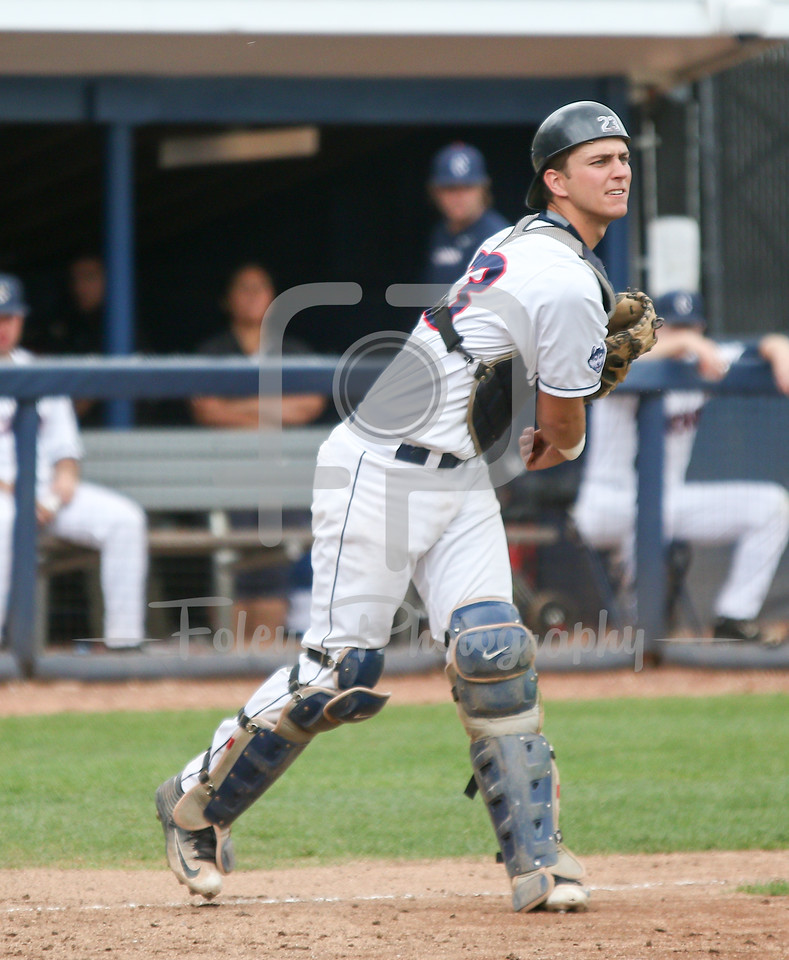 5/13/16 Storrs Connecticut: UConn catcher Zac Susi (23) throws to first during an American Athletic Conference matchup. The Huskies defeated the Knights 5-4 at J.O. Christian Field in Storrs, Connecticut.