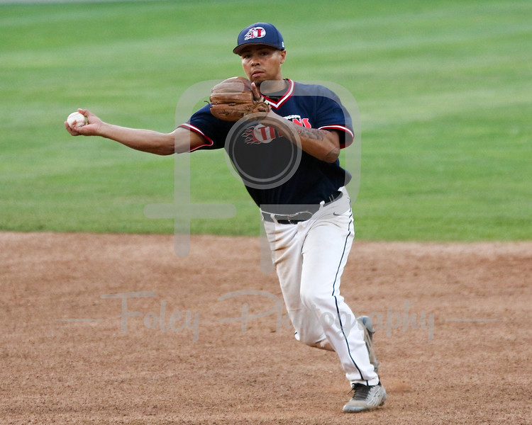 Worcester, MA: Torrington Titans 2b Jose Negron of Bridgeport (2) tosses a ball to first base during the Worcester  Bravehearts 2-1 victory over the Torrington Titans on 7/7/16.