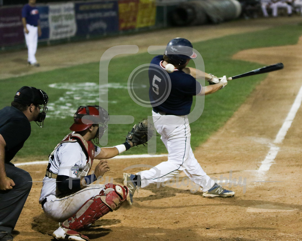Worcester, Massachusetts; Torrington Titans Mikey Arman (5) of Kenyon College hits a foul ball during a game between the Worcester Bravehearts and the Torrington on 7/7/16.