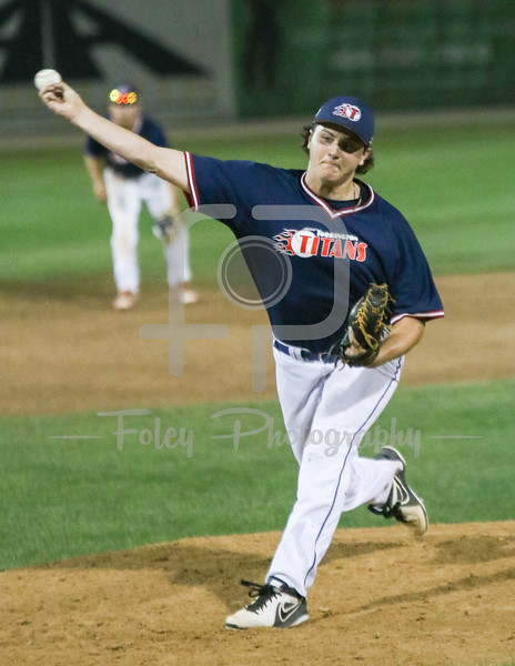 Worcester, MA: Torrington Titans Malachi Emond (18) of  Albertus Magnus tosses a pitch during the Worcester  Bravehearts 2-1 victory over the Torrington Titans on 7/7/16.