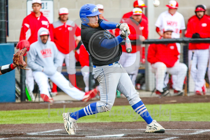Becker College Hawks first baseman Nick Harriman (22)