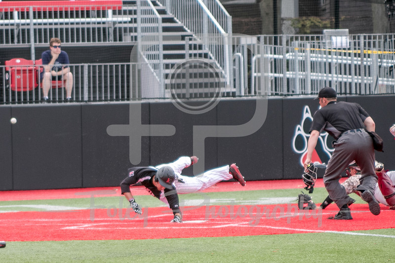 Northeastern Huskies infielder Scott Holzwasser (28)