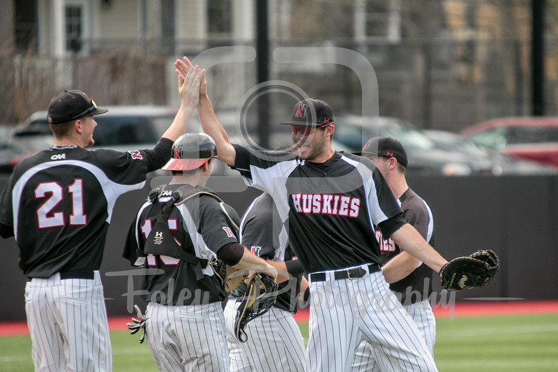 Northeastern Huskies outfielder Jake Farrell (18) Northeastern Huskies pitcher Tyler Brown (21)