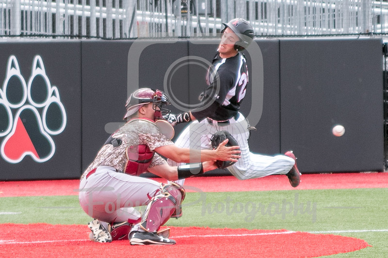 Northeastern Huskies infielder Scott Holzwasser (28) College of Charleston catcher Erven Roper (17)