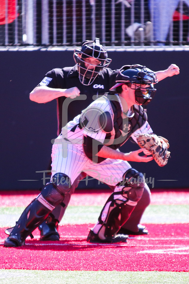 Northeastern Huskies catcher John Mazza (15) Umpire Chris Marshall