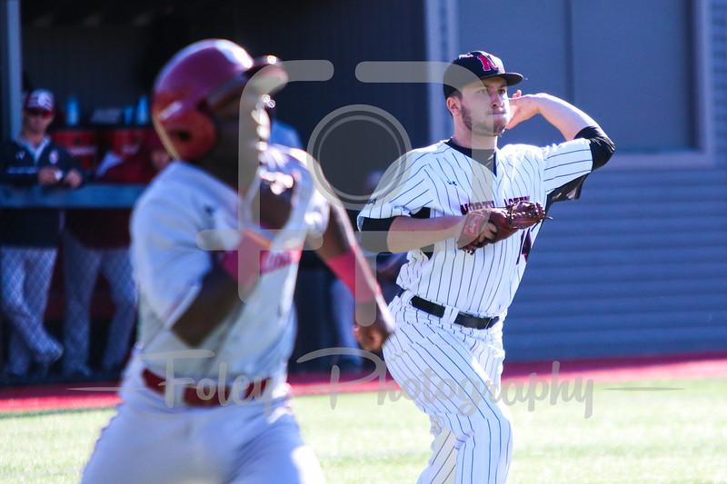 Northeastern Huskies pitcher Andrew Misiaszek (14) College of Charleston infielder Dupree Hart (5)