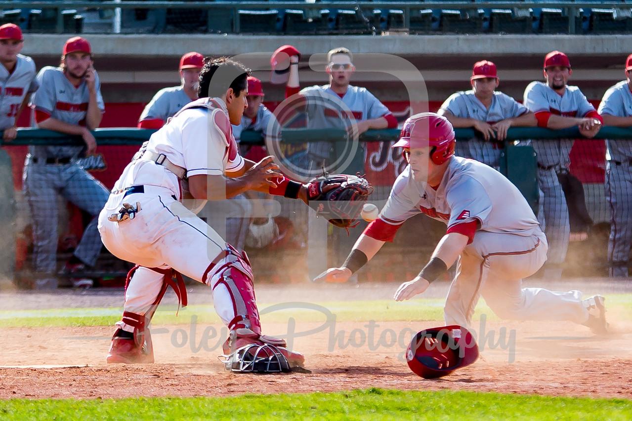 Stony Brook pitcher Aaron Pinto (26) Stony Brook catcher David Real (5) Hartford third baseman Chria Sullivan (7)
