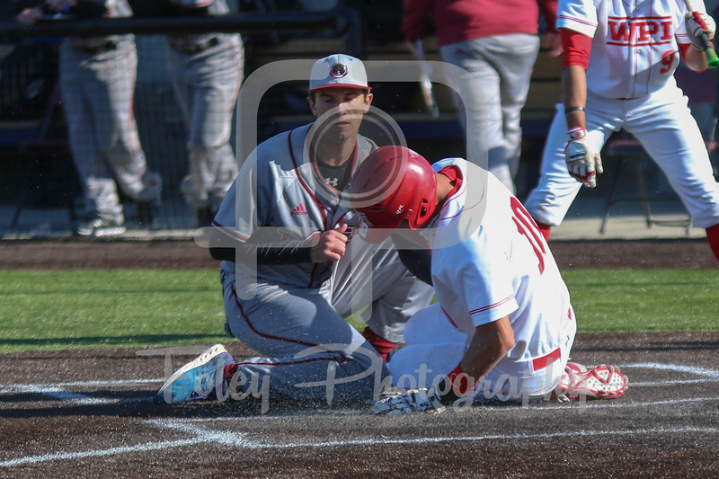 WPI Engineers outfielder Ryan Tropeano (10) MIT Engineers pitcher Zach Michaud (14)