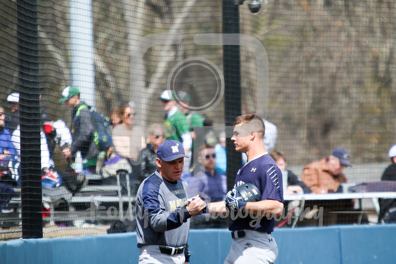 Navy Midshipmen outfielder Leland Saile (14) Navy Midshipmen head coach Paul Kostacopoulos