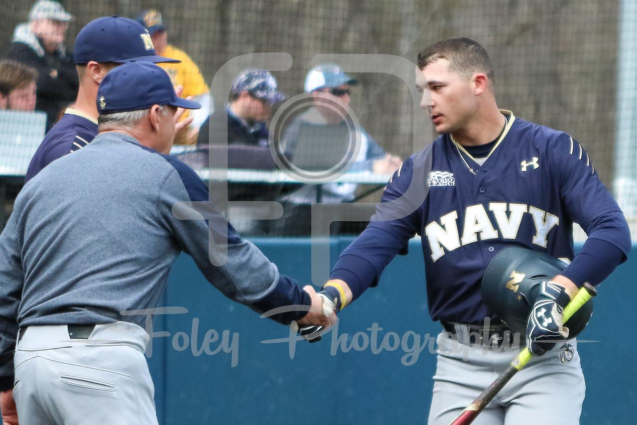 Navy Midshipmen infielder Jacob Williamson (22) Navy Midshipmen head coach Paul Kostacopoulos